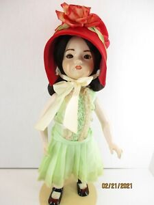 "15"" Repro Porcelain/ Bisque composition doll brown glass eye Green dress Red Hat"