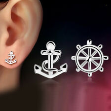 Mismatched silver tone steering wheel and anchor stud earrings