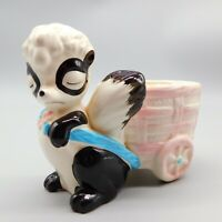 Vintage Ceramic Skunk pulling cart, figurine, baby planter Japan
