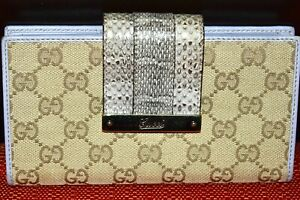 AUTH VERY STYLISH TIMELESS GUCCI LOGO W/PYTHON TRIMS LONG WALLET.