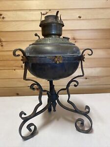 ANTIQUE JUNO? OIL LAMP WITH WROUGHT IRON STAND