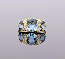 18CT GOLD AQUAMARINE & DIAMOND GALLERY RING
