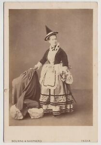 India cabinet-lady in fancy dress with pointed hat by Bourne & Shepherd of India