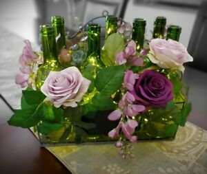 Country floral arrangement with silk flowers & 7 lighted wine bottles