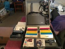 Vintage Polaroid 340 Land Camera, complete outfit, film, flashbulbs, and case