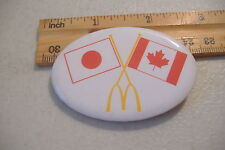 ~MCDONALDS~JAPAN & CANADA FLAGS~OVAL BUTTON PIN~