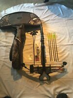 Bone Collector Cross Bow. 5 carbon & 3 target arrows. GW case & misc items.