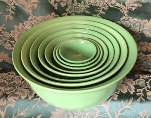 7 green ceramic nesting bowls -  no marks of use, efficient for storage space