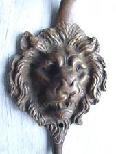 Bronze lionshead mask coat hook