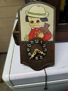 small old novilty all wood clock,, (with moving eyes )