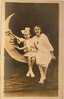Real Photo Postcard RPPC ~ Two Girls Sitting On Paper Moon Studio Prop