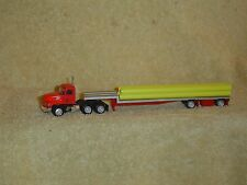 PROMOTEX MACK CH W/48'SPREAD AXLE FLATBED TRAILER & LOAD