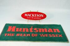 (2) Vintage Beer Collectibles, Mackeson Bar Plaque, Huntsman Bar Towel