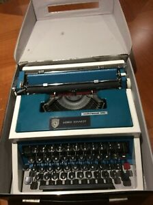Vintage Blue  Portable Underwood 315 typewriter w/case.