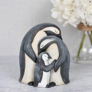 Penguin hugging family ornament