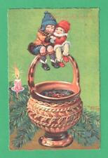 UNUSUAL POLISH ARTIST SIGNED CHRISTMAS POSTCARD GIRLS ATOP URN HANDLE CANDLE FIR