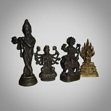 A group of four miniature bronze statues  | Krishna, Shiva, Thai Buddha