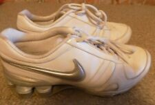 NIKE SHOX WOMENS 7.5 WHITE AND SILVER ATHLETIC SHOES