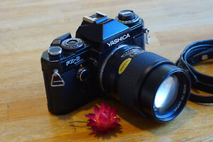 Yashica FX-D Quartz SLR with Yashica ML 135 F2.8 C Lens in very good condition.