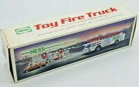 HESS TOY FIRE TRUCK WITH DUAL SOUND SIREN 1989  IN ORIGINAL BOX (BROKEN WHEEL)