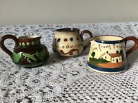 3 small Torquay Ware/ Watcombe milk jugs - souvenir and motto ware