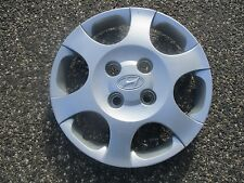 one 2001 to 2003 Hyundai Elantra 15 inch bolt on hubcap wheel cover