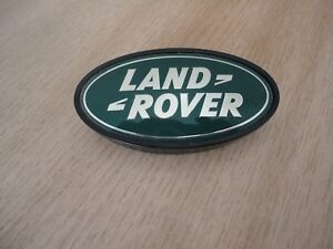 LAND ROVER DISCOVERY 1 FRONT GRILLE BADGE MXC5323 NEW GENUINE PART