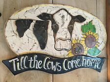 Till the Cows Come Home Sign on old wood