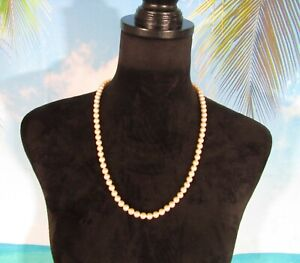 """Necklace with a Strand of Off White Faux Pearls 24"""""""