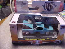 M2 Machines 1965 Ford Mustang GT 2+2 Fastback Light Blue with Real Riders