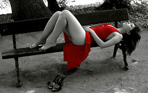 Framed Print - Woman in Red Dress Laying on Park Bench Black & White (Picture)