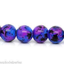 30 perles en verre bleu effet moucheté 8 mm