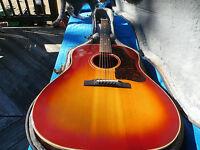 1962 Gibson J-45 ,adjustable bridge, cherry sunburst real nice condition.