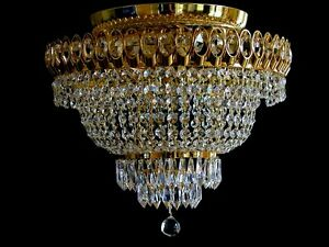Ceiling chandelier in gold color with real crystals. matching wall lights avail.