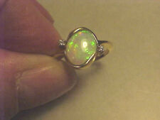 Colorful and Vibrant Genuine Opal ring with tiny Diamond Accents
