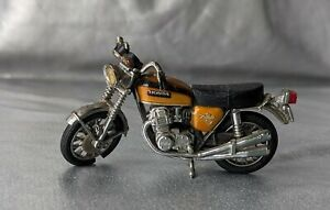 HONDA CB 750 FOUR. CANDY GOLD DIECAST MOTORCYCLE TOY.