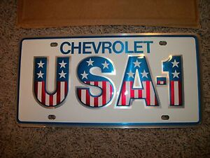 NOS Small hole USA-1 U.S.A.-1 Chevrolet GM Dealer Dealership License Plate Nice!