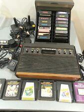 C Vintage Atari 2600 System controllers paddles joysticks Games untested woodie