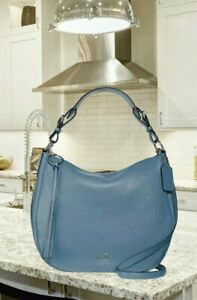 Coach Sutton Hobo in Polished Pebble Leather Slate/Silver. Authentic from Macy's