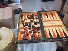 A vintage checkers and backgammon that opens like a book