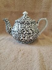 """Darice Black Floral Paisley Teapot. 9"""" Wide by 6"""" Tall."""