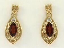 Ladies Genuine Garnet and Diamond Earrings in 14 Kt Yellow Gold