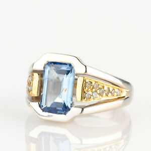 Ladies ring (18k gold) with a sapphire and diamonds