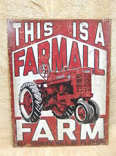 This is a Farmall Farm International Tractor Advertising Tin Metal Sign Decor
