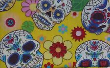 metre cotton poplin with retro design of skulls in black, turquoise, yellow
