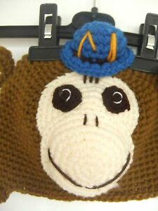 hand knit hat brown white blue yellow, with st. trinians style school hat