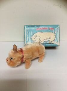 Sniffing Rooting Pig Windup Toy