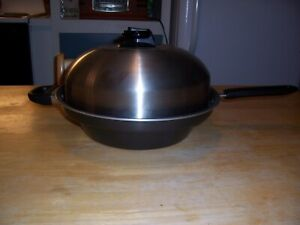 The Turbo Cooker 4 Piece Stainless Pan Cooking System
