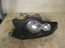2009 Kawasaki Brute Force 650 Left headlight and bezel.