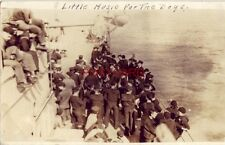 RPPC - A LITTLE MUSIC FOR THE BOYS sailors listening to impromptu band on deck